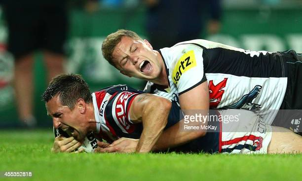 Mitchell Pearce of the Roosters scores a try in the tackle of Matt Moylan during the NRL 1st Qualifying Final match between the Sydney Roosters and...