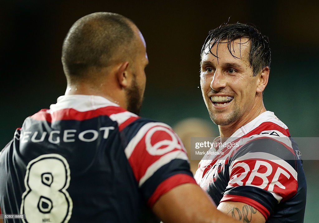 <a gi-track='captionPersonalityLinkClicked' href=/galleries/search?phrase=Mitchell+Pearce&family=editorial&specificpeople=4208962 ng-click='$event.stopPropagation()'>Mitchell Pearce</a> of the Roosters smiles after a Roosters try during the round nine NRL match between the Sydney Roosters and the Newcastle Knights at Allianz Stadium on April 30, 2016 in Sydney, Australia.