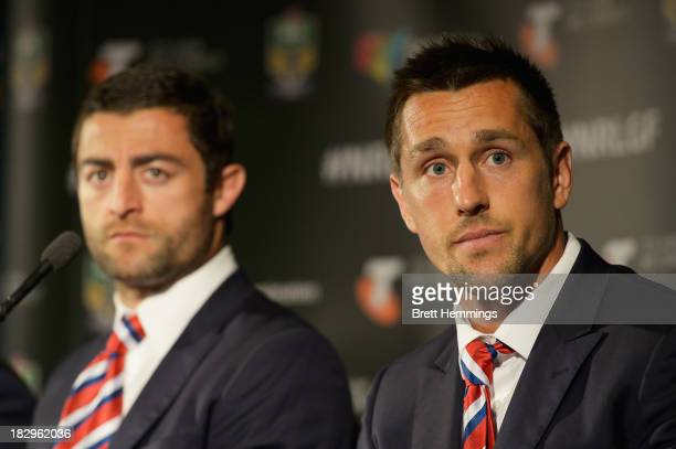 Mitchell Pearce of the Roosters speaks to the media as Anthony Minichiello looks on during the NRL Grand Final press conference at Star City on...