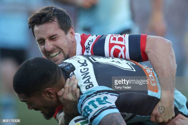 Mitchell Pearce of the Roosters tackles Ricky Leutele of the Sharks during the round 17 NRL match between the Sydney Roosters and the Cronulla Sharks...