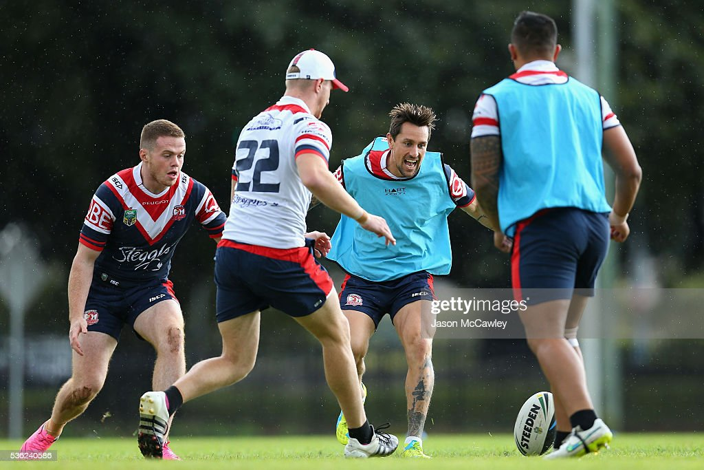 <a gi-track='captionPersonalityLinkClicked' href=/galleries/search?phrase=Mitchell+Pearce&family=editorial&specificpeople=4208962 ng-click='$event.stopPropagation()'>Mitchell Pearce</a> of the Roosters warms up with teammates during a Sydney Roosters NRL training session at Moore Park on June 1, 2016 in Sydney, Australia.