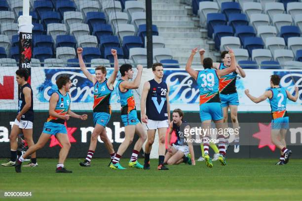 Mitchell Podhajski of Vic Metro reacts as Allies players celebrate the close win on the final siren during the U18 AFL Championships match between...