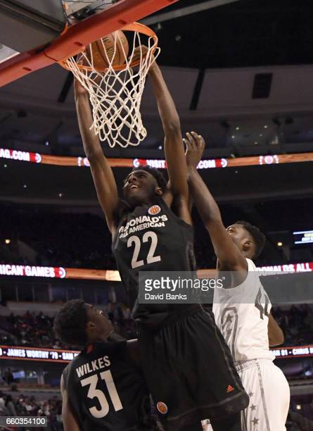 Mitchell Robinson of the boys east team dunks on Brandon L McCoy of the boys west team during the 2017 McDonalds's All American Game on March 29 2017...