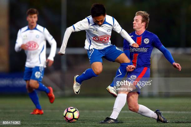 Mitchell Rooke of Manly United and Yu Kuboki of Sydney Olympic challenge for the ball during the NSW NPL 1 Elimination Final between Manly United FC...