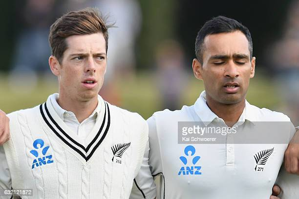 Mitchell Santner and Jeet Raval of New Zealand line up for their national anthem during day one of the Second Test match between New Zealand and...