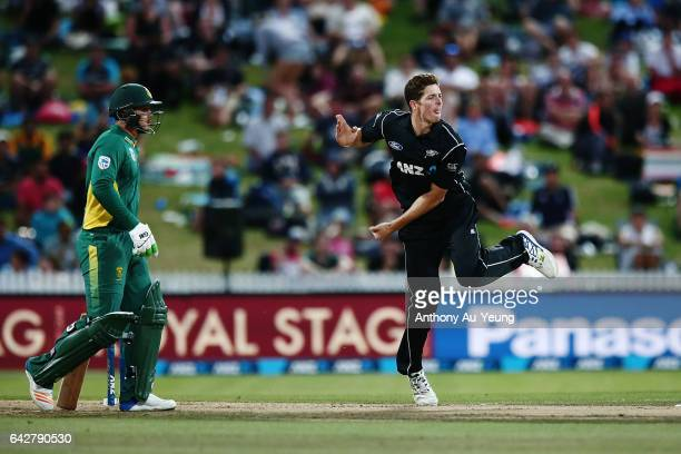 Mitchell Santner of New Zealand bowls during the First One Day International match between New Zealand and South Africa at Seddon Park on February 19...