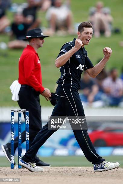 Mitchell Santner of New Zealand celebrates his wicket of David Miller of South Africa during game four of the One Day International series between...