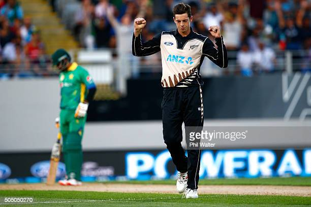 Mitchell Santner of New Zealand celebrates his wicket of Shoaib Malik of Pakistan during the first T20 match at Eden Park on January 15 2016 in...