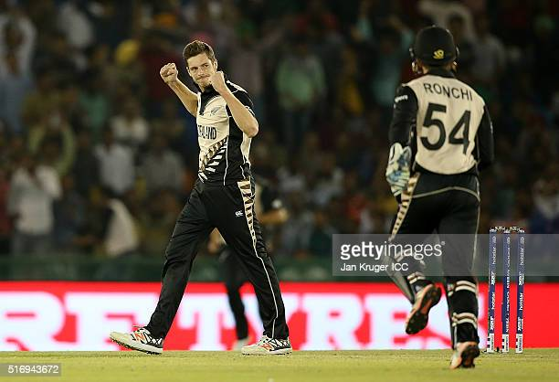 Mitchell Santner of New Zealand celebrates the wicket of Ahmad Shazad of Pakistan during the ICC World Twenty20 India 2016 Super 10s Group 2 match...
