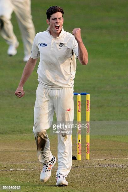 Mitchell Santner of New Zealand celebrates the wicket of Quinton de Kock of the Proteas during day 1 of the 1st Sunfoil International Test match...