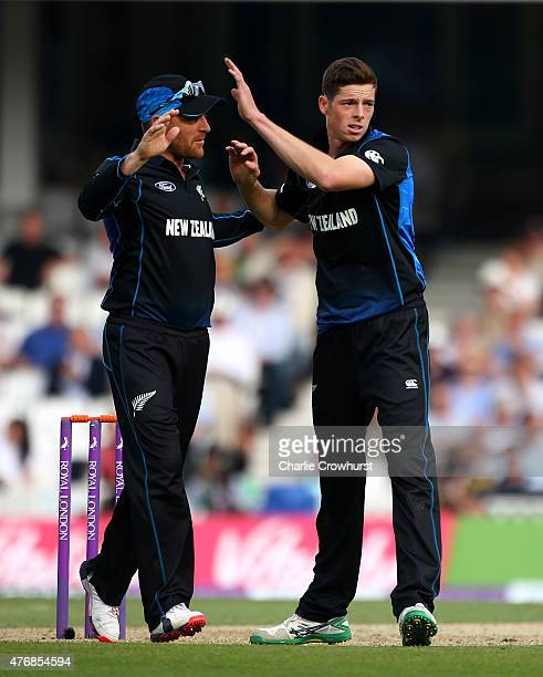Mitchell Santner of New Zealand celebrates with captain Brendon McCullum after claiming the wicket of Joe Root of England during the the 2nd ODI...