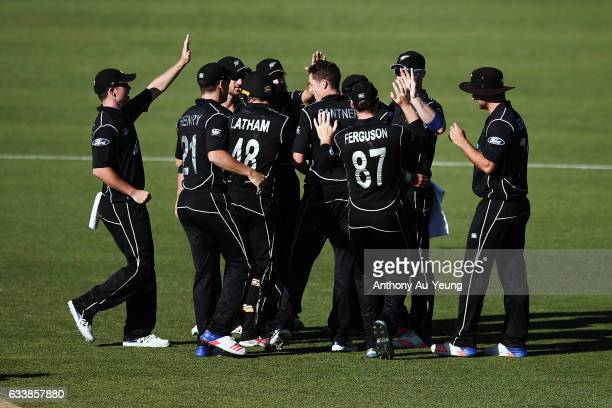 Mitchell Santner of New Zealand celebrates with teammates for the wicket of Marcus Stoinis of Australia during game three of the One Day...
