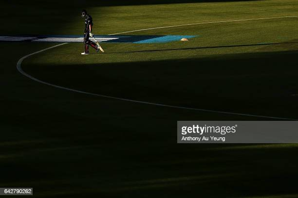 Mitchell Santner of New Zealand departs after being dismissed by Kagiso Rabada of South Africa during the First One Day International match between...