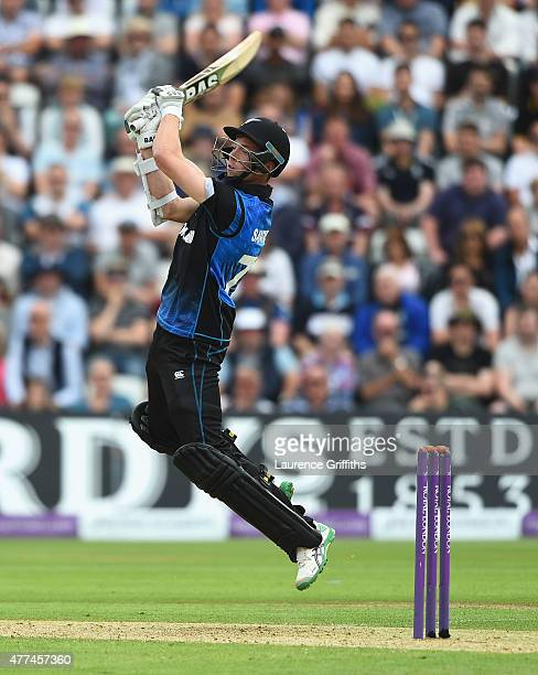 Mitchell Santner of New Zealand hits out during the 4th ODI Royal London OneDay International between England and New Zealand at Trent Bridge on June...