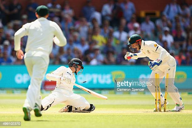 Mitchell Santner of New Zealand is stumped out by Australian wicket keeper Peter Nevill off a delivery by Nathan Lyon of Australia during day three...