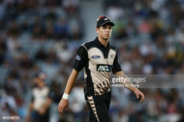 Mitchell Santner of New Zealand looks on during the first International Twenty20 match between New Zealand and South Africa at Eden Park on February...