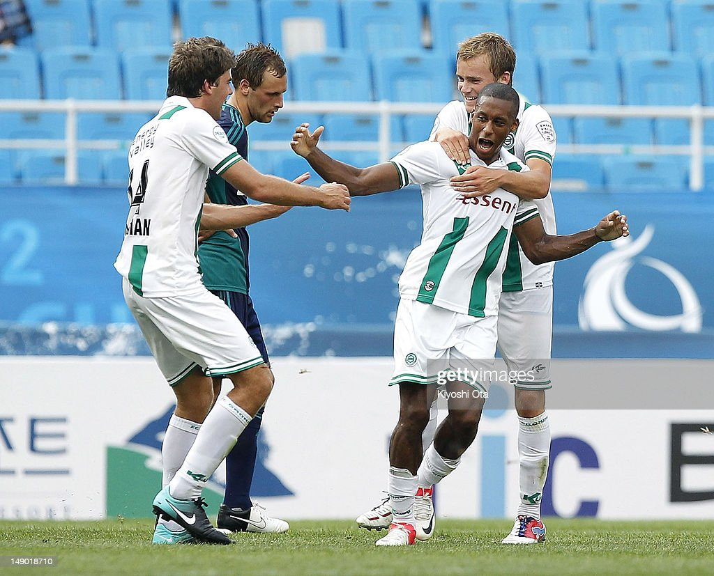Mitchell Schet of FC Groningen celebrates his goal against Sunderland with teammates during the Peace Cup 3rd place playoff match between Sunderland...