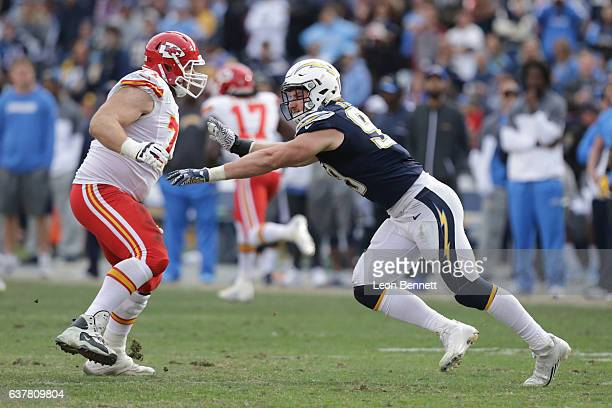 Mitchell Schwartz of the Kansas City Chiefs defends his quarterback against Joey Bosa of the San Diego Chargers during a NFL game at Qualcomm Stadium...