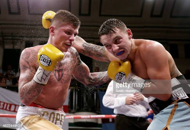 Mitchell Smith in action with Peter Cope during their Super Featherweight bout at York Hall on July 16 2014 in London England