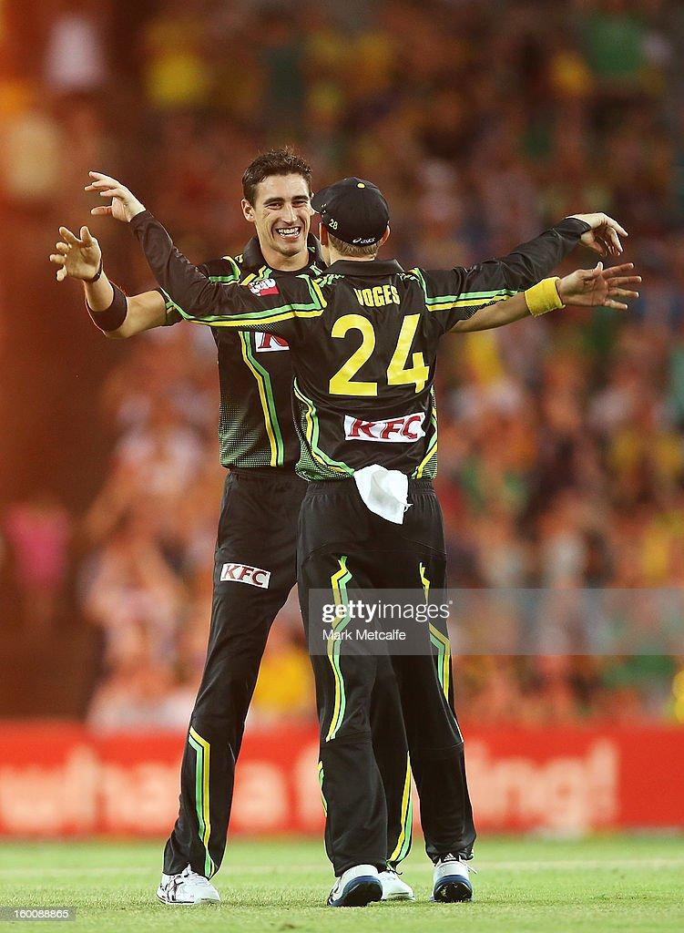 Mitchell Starc and Adam Voges of Australia celebrate taking the wicket of Lahiru Thirimanne of Sri Lanka during game one of the Twenty20 international match between Australia and Sri Lanka at ANZ Stadium on January 26, 2013 in Sydney, Australia.