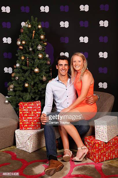 Mitchell Starc and Alyssa Healy pose for a photo during an Australian Test squad Christmas Lunch at Melbourne Cricket Ground on December 25 2014 in...
