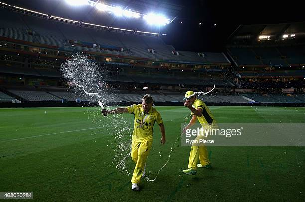 Mitchell Starc and David Warner of Australia celebrate on the ground at 215am after the 2015 ICC Cricket World Cup final match between Australia and...