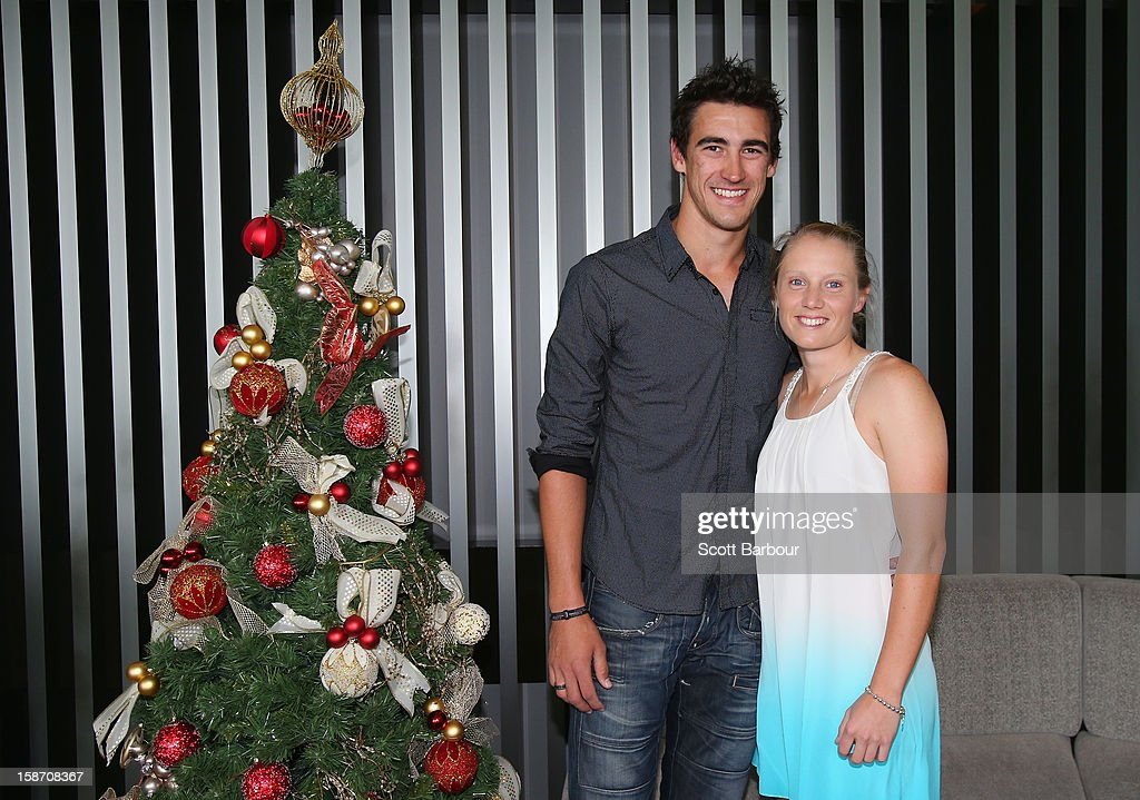 <a gi-track='captionPersonalityLinkClicked' href=/galleries/search?phrase=Mitchell+Starc&family=editorial&specificpeople=6475541 ng-click='$event.stopPropagation()'>Mitchell Starc</a> and girlfriend Alyssa Healy pose next to a Christmas tree ahead of a Cricket Australia Christmas Day lunch at Crown Entertainment Complex on December 25, 2012 in Melbourne, Australia.