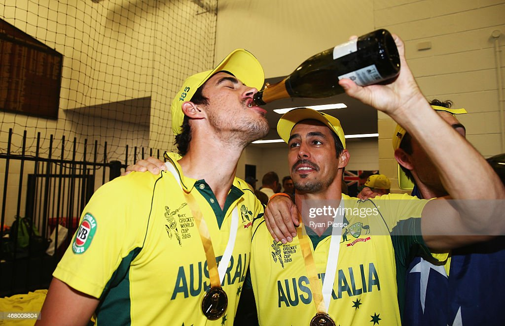 Mitchell Starc and Mitchell Johnson of Australia celebrate in the change rooms after the 2015 ICC Cricket World Cup final match between Australia and...