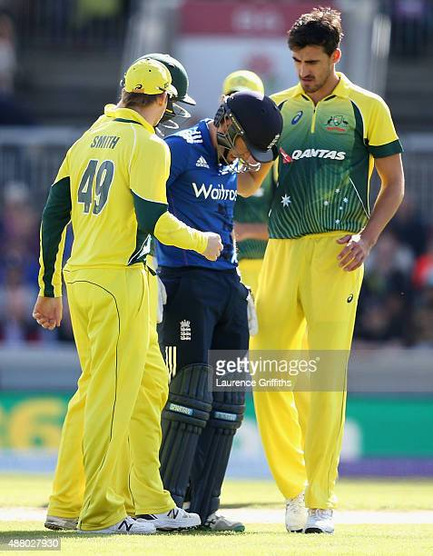 Mitchell Starc and Steve Smith of Australia show concern for Eoin Morgan of England after being struck on the head by a short ball during the 5th...