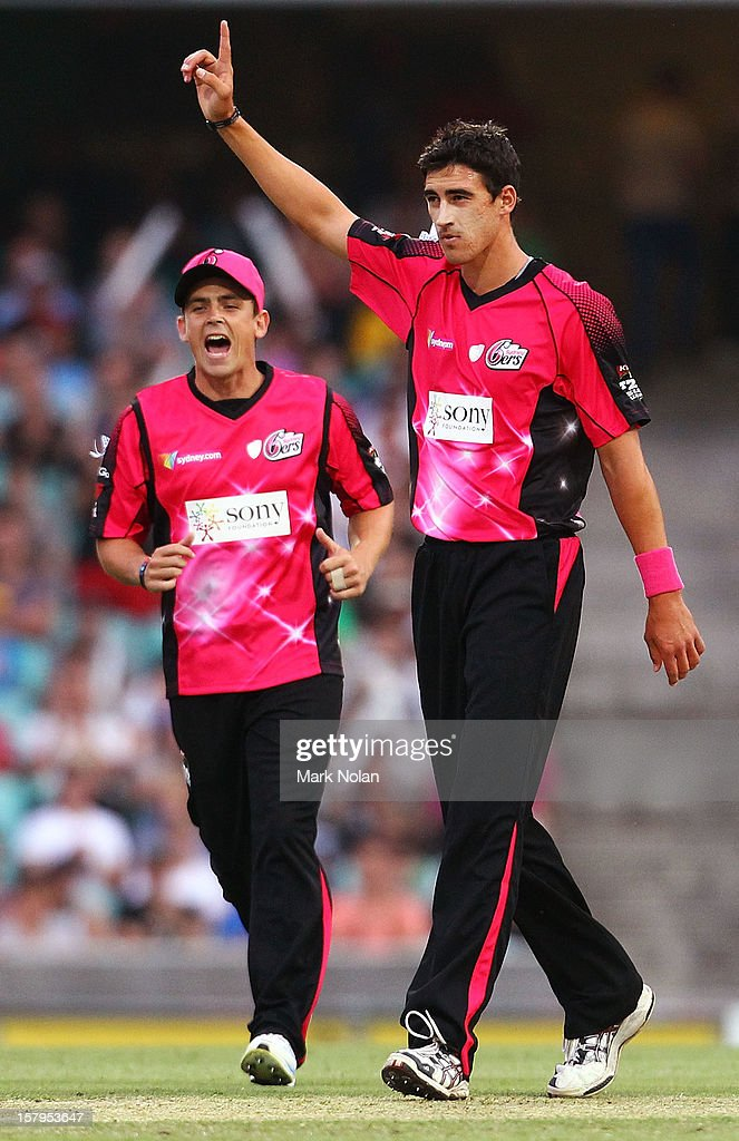 Mitchell Starc celebrates getting the wicket of Usman Khawaja during the Big Bash League match between the Sydney Sixers and the Sydney Thunder at Sydney Cricket Ground on December 8, 2012 in Sydney, Australia.