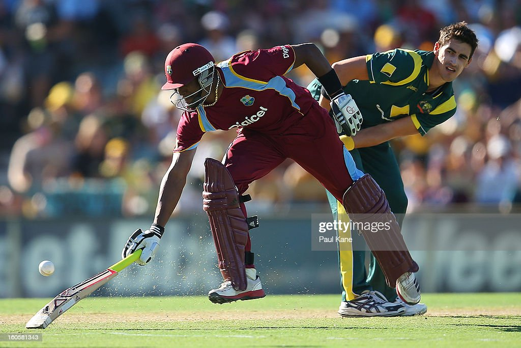 Mitchell Starc of Australia attempts to run out Dwayne Bravo of the West Indies during game two of the Commonwealth Bank One Day International Series between Australia and the West Indies at WACA on February 3, 2013 in Perth, Australia.