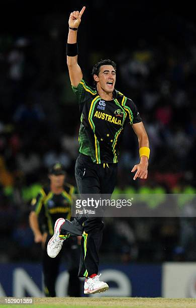 Mitchell Starc of Australia celebrate the wicket of Rohit Sharma of India during the super eight match between Australia and India held at R...