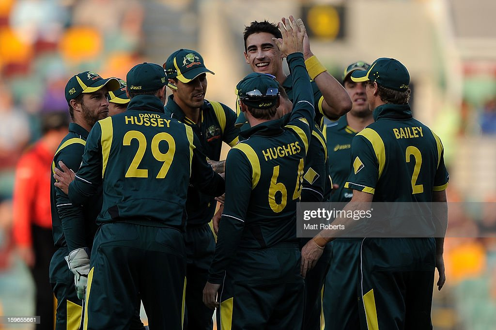 Mitchell Starc (C) of Australia celebrates a wicket during game three of the Commonwealth Bank one day international series between Australia and Sri Lanka at The Gabba on January 18, 2013 in Brisbane, Australia.
