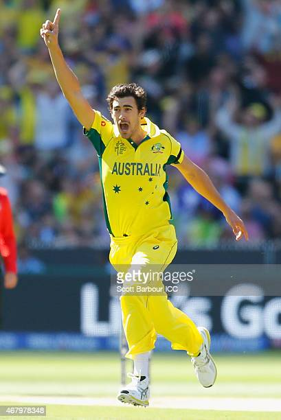 Mitchell Starc of Australia celebrates after bowling Brendon McCullum of New Zealand during the 2015 ICC Cricket World Cup final match between...