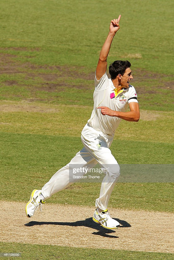 Mitchell Starc of Australia celebrates after claiming the wicket of Murali Vijay of India during day two of the Fourth Test match between Australia...