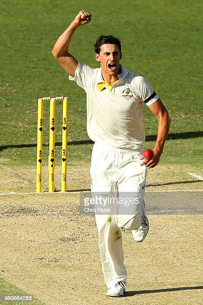 Mitchell Starc of Australia celebrates after dismissing Murali Vijay of India during day three of the 2nd Test match between Australia and India at...