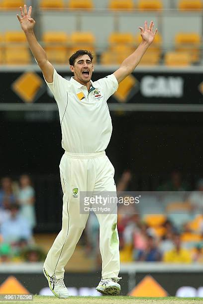 Mitchell Starc of Australia celebrates after dismissing Tom Latham of New Zealand during day four of the First Test match between Australia and New...