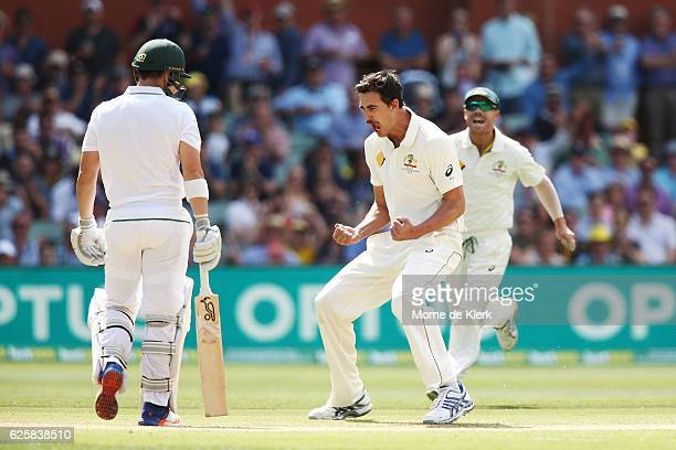 Mitchell Starc of Australia celebrates after getting the wicket of Dean Elgar of South Africa during day three of the Third Test match between...