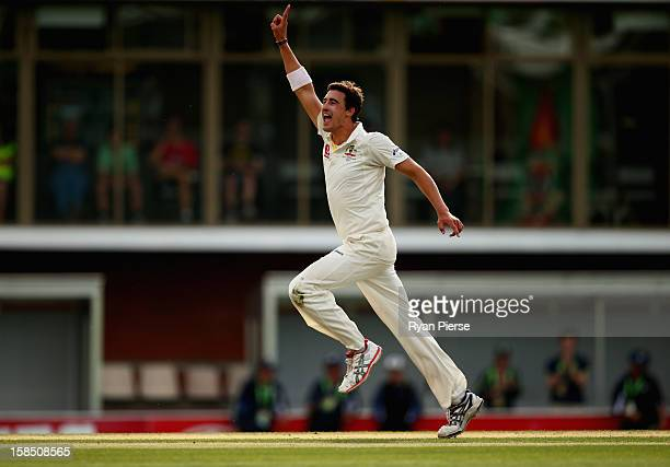 Mitchell Starc of Australia celebrates after taking the final wicket to claim victory during day five of the First Test match between Australia and...