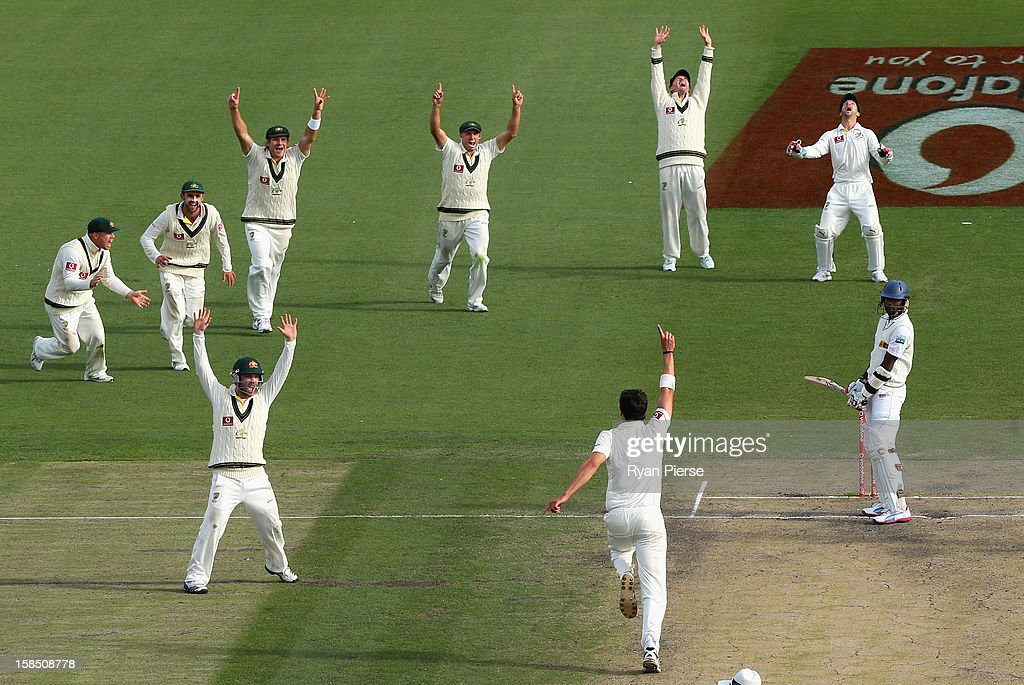 Mitchell Starc of Australia celebrates after taking the final wicket of Shaminda Eranga of Sri Lanka to claim victory during day five of the First Test match between Australia and Sri Lanka at Blundstone Arena on December 18, 2012 in Hobart, Australia.