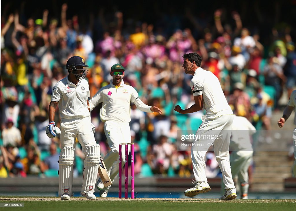 <a gi-track='captionPersonalityLinkClicked' href=/galleries/search?phrase=Mitchell+Starc&family=editorial&specificpeople=6475541 ng-click='$event.stopPropagation()'>Mitchell Starc</a> of Australia celebrates after taking the wicket of <a gi-track='captionPersonalityLinkClicked' href=/galleries/search?phrase=Murali+Vijay&family=editorial&specificpeople=5592328 ng-click='$event.stopPropagation()'>Murali Vijay</a> of India during day two of the Fourth Test match between Australia and India at Sydney Cricket Ground on January 7, 2015 in Sydney, Australia.