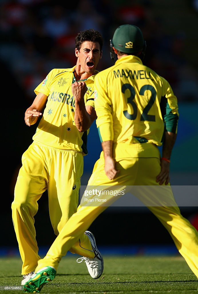 Mitchell Starc of Australia celebrates after taking the wicket of Grant Elliott of New Zealand during the 2015 ICC Cricket World Cup match between...