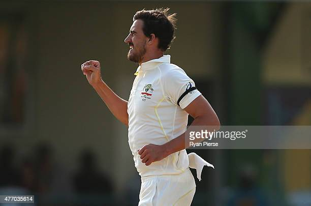 Mitchell Starc of Australia celebrates after taking the wicket of Rajendra Chandrika of West Indies during day three of the Second Test match between...