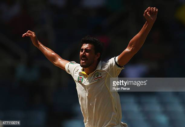 Mitchell Starc of Australia celebrates after taking the wicket of Shane Dowrich of West Indies during day four of the Second Test match between...