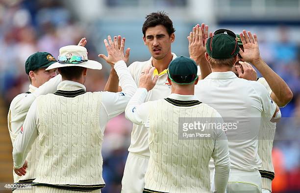 Mitchell Starc of Australia celebrates after taking the wicket of Moeen Ali of England during day two of the 1st Investec Ashes Test match between...