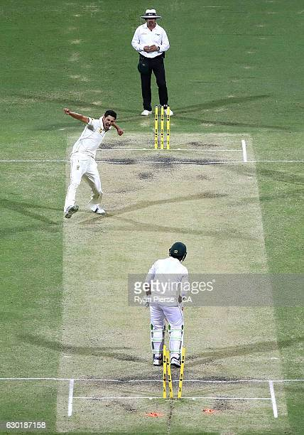 Mitchell Starc of Australia celebrates after taking the wicket of Sarfraz Ahmed of Pakistan during day four of the First Test match between Australia...