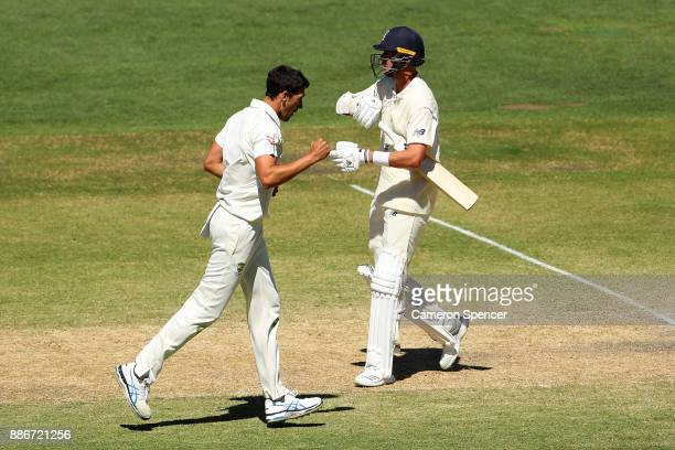 Mitchell Starc of Australia celebrates after taking the wicket of Stuart Broad of England during day five of the Second Test match during the 2017/18...