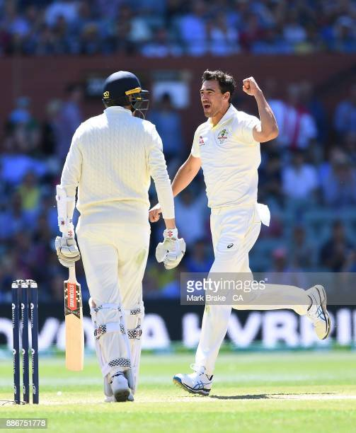 Mitchell Starc of Australia celebrates after taking the wicket of Craig Overton of Englandduring day five of the Second Test match during the 2017/18...