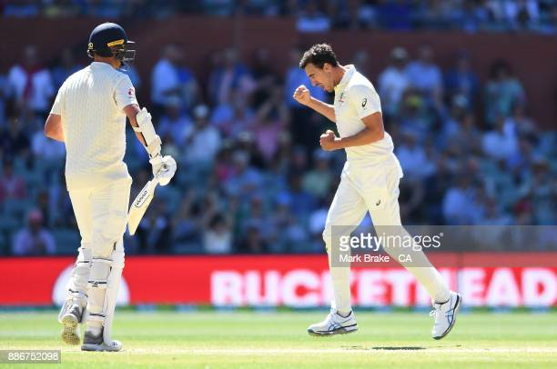 Mitchell Starc of Australia celebrates after taking the wicket of Stuart Broad of Englandduring day five of the Second Test match during the 2017/18...