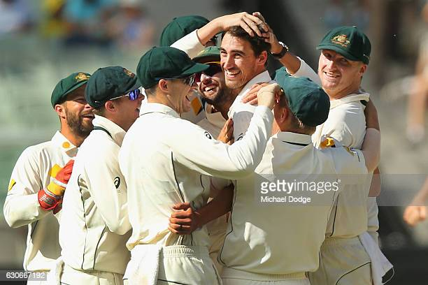 Mitchell Starc of Australia celebrates bowling Sarfraz Ahmed of Pakistan during day five of the Second Test match between Australia and Pakistan at...